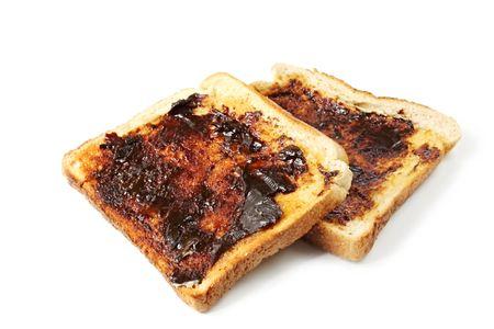 Vegemite on toast, an Australian icon.  Isolated on white. Stock Photo