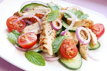 red onion: Chicken salad with cucumber and mint.  Chicken marinated in spiced yoghurt, with cucumber, cherry tomatoes, mint leaves and red onion.  A delicious, healthy meal.
