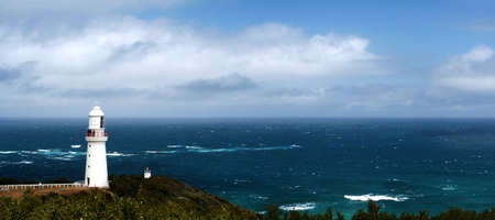commissioned: Lighthouse at Cape Otway, Victoria, Australia, commissioned in the 1830s, looking out over the wild Southern Ocean. Stock Photo