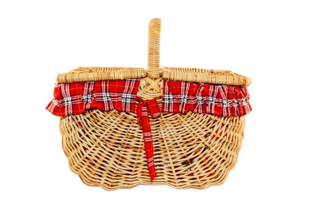 Cheerful cane picnic basket with red and white check liner, isolated on white. photo