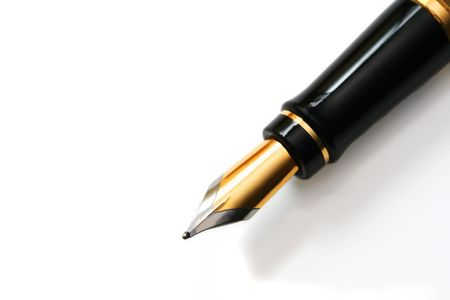 Closeup of a classy, gold-nibbed fountain pen, over white background. photo