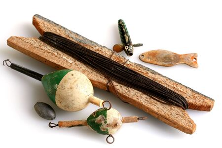 sinkers: Vintage fishing tackle ~ line, sinkers, lures, floats ~ isolated on white