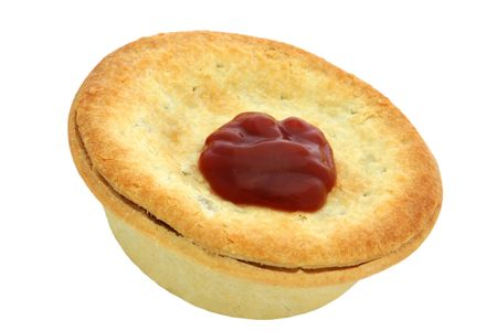 Traditional Aussie Meat Pie with Tomato Sauce.  Isolated on white.  Football food!