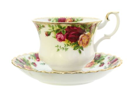 A classic gold-rimmed floral china teacup and saucer.  Isolated on white. Stock Photo