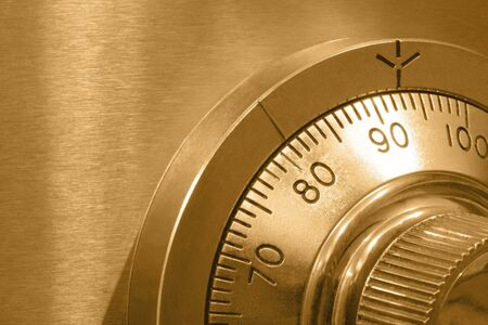 Closeup of combination safe lock, with golden tone. Stock Photo - 2356300