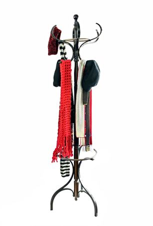 Vintage coat rack with winter hats and scarves.  Isolated on white.