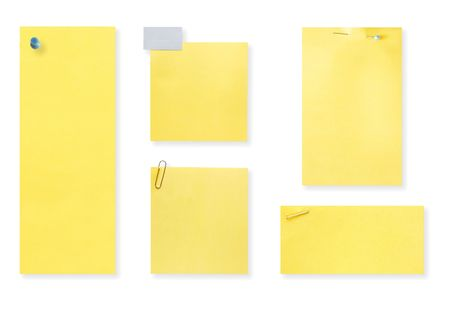 Blank yellow notes.  Different sizes, fastened with pushpin, staple, paperclip, straight pin, and tape.  With drop shadow, isolated on white, ready for your messages. photo