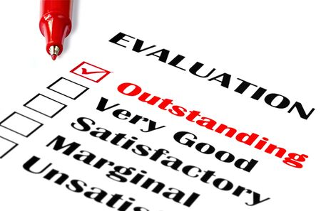 Outstanding evaluation.  Red pen on evaluation, with  Stock Photo - 2407340