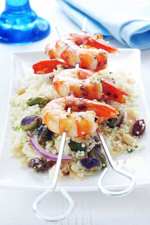barbecued: Barbecued prawns on a couscous salad, with toasted pistacchios, almonds, pine nuts and raisins.