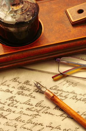 Vintage nib pen and inkwell, on page of 18th Century text. Stock Photo