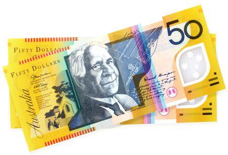 50: Australian fifty dollar notes, on white. Stock Photo