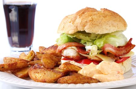 wedges: Home-made chicken and bacon burger, served with spicy potato wedges and a sweet chili dipping sauce. Stock Photo
