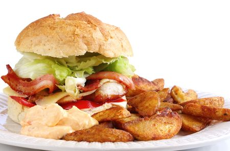 Home-made chicken and bacon burger, served with spicy potato wedges and a sweet chili dipping sauce. Stock Photo - 2586534
