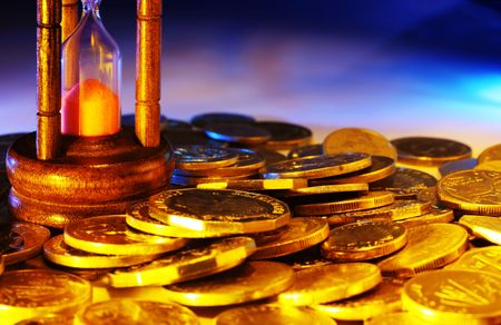 beat the clock: Hourglass and coins, with warm gold and blue lighting.  Time is money.