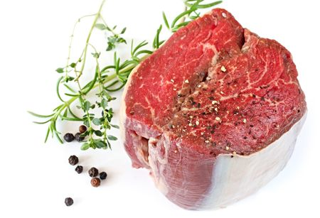 peppercorns: Best cut of beef fillet steak, ready for cooking.  With peppercorns, rosemary and thyme.