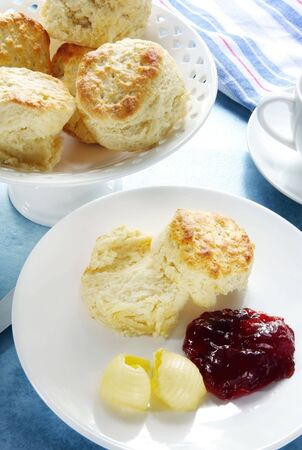 homely: Scones, home-made, served with strawberry jam and butter.  A homely, traditionally English treat.