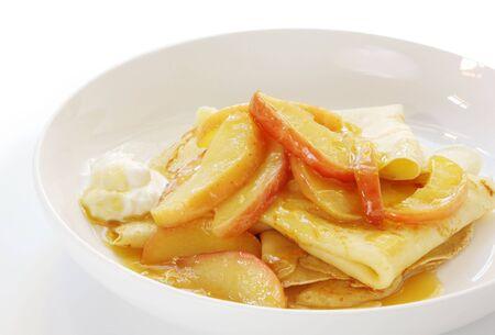 indulgence: Sweet crepes with apple caramel and cream.  Wicked indulgence! Stock Photo
