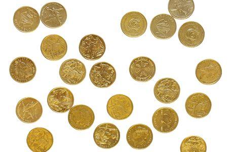dollar coins: Australian dollar coins scattered on white background.