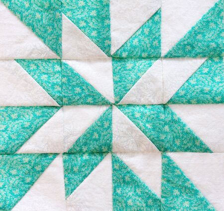 patchwork quilt: Quilting square, in close-up, in shades of green and white. Stock Photo