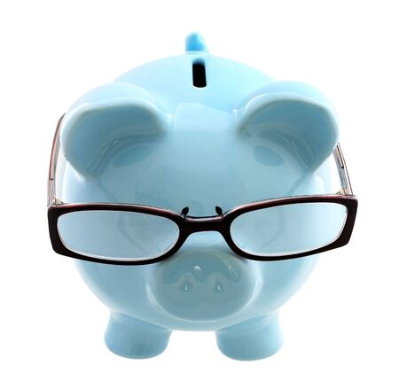 Piggy bank wearing spectacles - a thoughtful investor. Stock Photo
