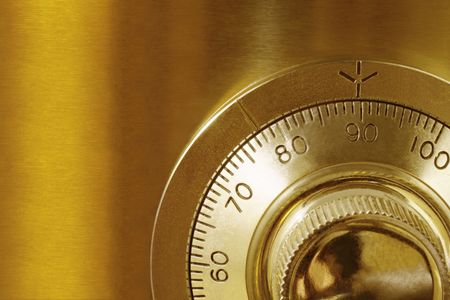 Golden safe lock, in close-up.