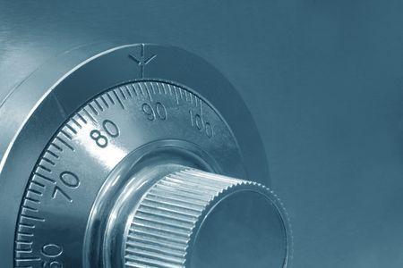 cyan: Combination safe lock, close-up view, in cyan tone.