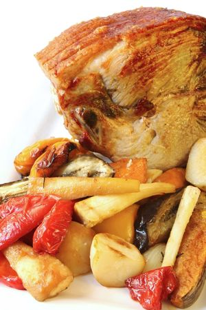 crackling: Roast pork with vegetables.  Leg of pork with crackling, surrounded by roasted potatoes, bell peppers, pumpkin, sweet potato, parsnip, onions and eggplant.