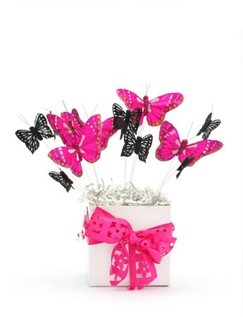 pink ribbon: Gift box of vibrant pink and black lace butterflies.   Stock Photo