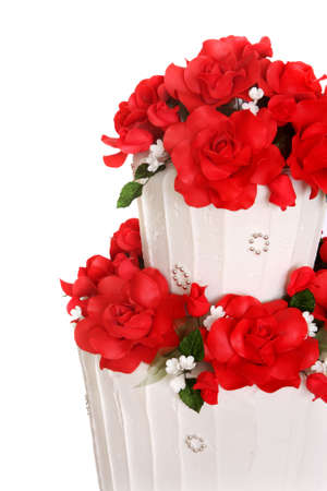 cake tier: Wedding cake decorated with vibrant red roses.  Close-up view. Stock Photo