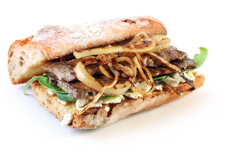 steak sandwich: Steak sandwich.  Beef steak on a toasted baguette bread roll, with goats cheese, spinach, and grilled onion.  Delicious!