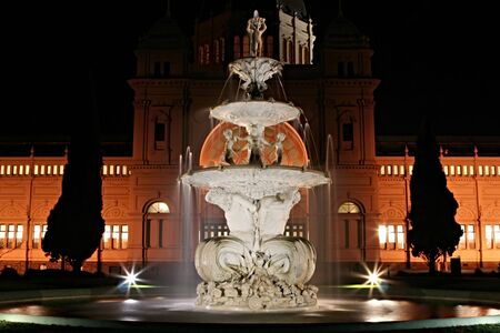 florentine: Graceful fountain in front of the Royal Exhibition Buildings, Melbourne, Australia.  Night view of this 19th Century Florentine landmark.