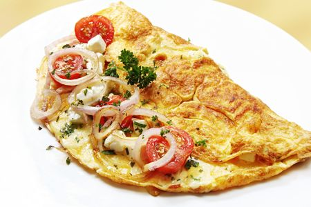 omelette: Omelette with cherry tomatoes, red onion, mozzarella, goats cheese and herbs.  A delicious, nutritious breakfast.