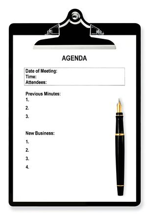 Meeting agenda on clipboard, with fountain pen. photo