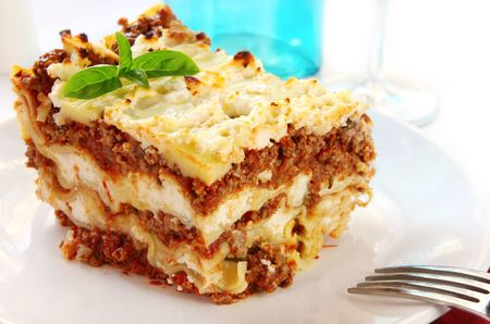 entrees: Lasagne, garnished with basil, ready to eat.