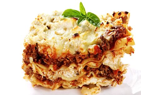 entrees: Serving of home-baked lasagne, garnished with basil. Stock Photo