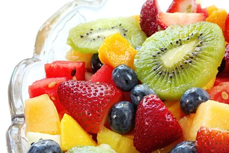 luscious: Fresh fruit salad in a crystal bowl.  Luscious healthy eating, with kiwi fruit, strawberries, blueberries, canteloupe, watermelon, mango, oranges, and passionfruit Stock Photo