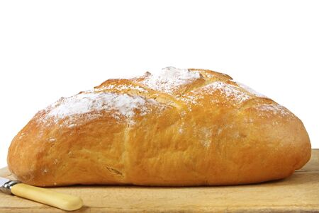 unsliced: Loaf of fresh sourdough bread, isolated on white. Stock Photo