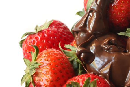 indulgent: Strawberries dripping with melted dark chocolate.  A delicious indulgent treat.