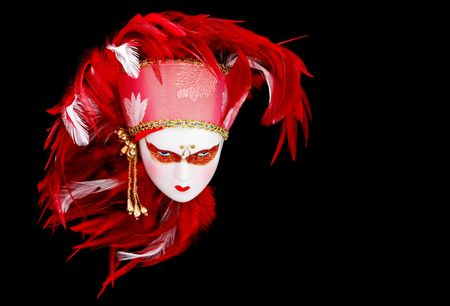 Venetian mask doll with vibrant red and white feathered headdress. Stock Photo - 3161780