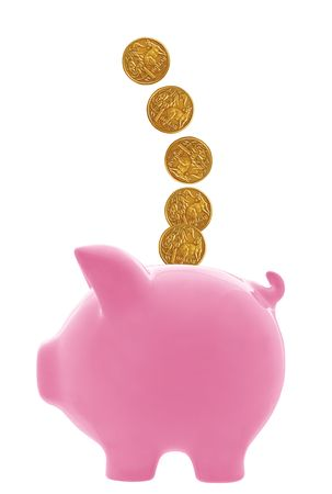 dollar coins: Australian dollar coins cascading into pink piggy bank.  Isolated on white. Stock Photo