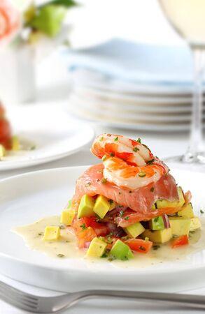 salmon dinner: Smoked salmon with avocado salsa, topped with king prawns,