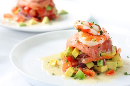 king salmon: Smoked salmon with an avocado and tomato salsa, topped with king prawns.