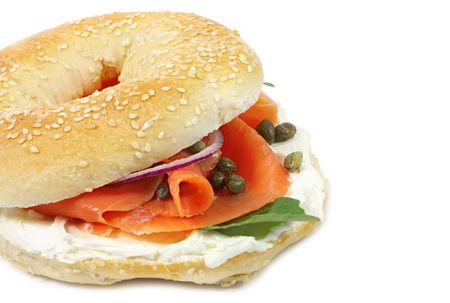 bagel: Bagel with smoked salmon, cream cheese, capers, and red onions.  Isolated on white.