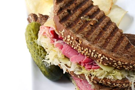 reuben: Reuben sandwich on rye bread, with corned beef, sauerkraut and Swiss cheese.  Served with a pickle and potato chips on the side.