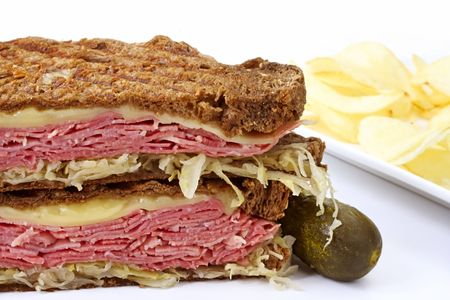 reuben: Traditional Reuben sandwich, with grilled rye bread, corned beef, melted Swiss cheese and sauerkraut.  Served with a pickle and potato chips.