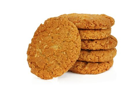 treacle: Australian icon - Anzac biscuits, isolated on white.  Made from rolled oats, coconut, treacle, butter and sugar.  Delicious! Stock Photo