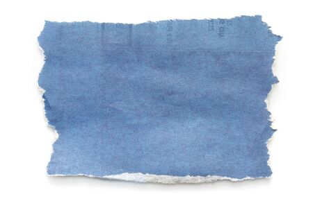 newsprint: Torn blue-toned newspaper, casting natural shadow on white.