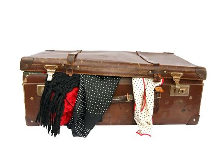 Vintage brown leather suitcase, with scarves overflowing.  Clipping path included. photo