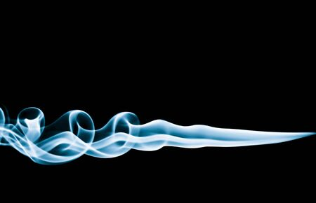 Cyan smoke trails, with black background. photo