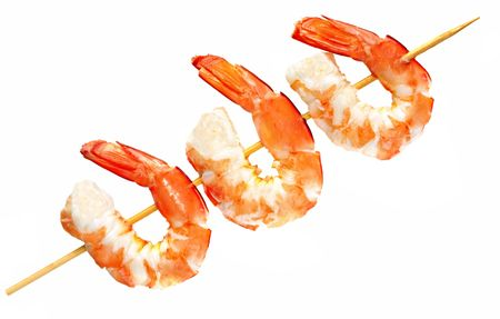 crustaceans: Bamboo skewer with three king prawns, isolated on white.